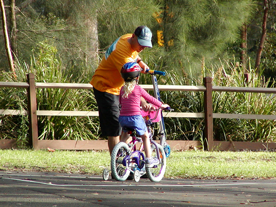 Adult and child biking