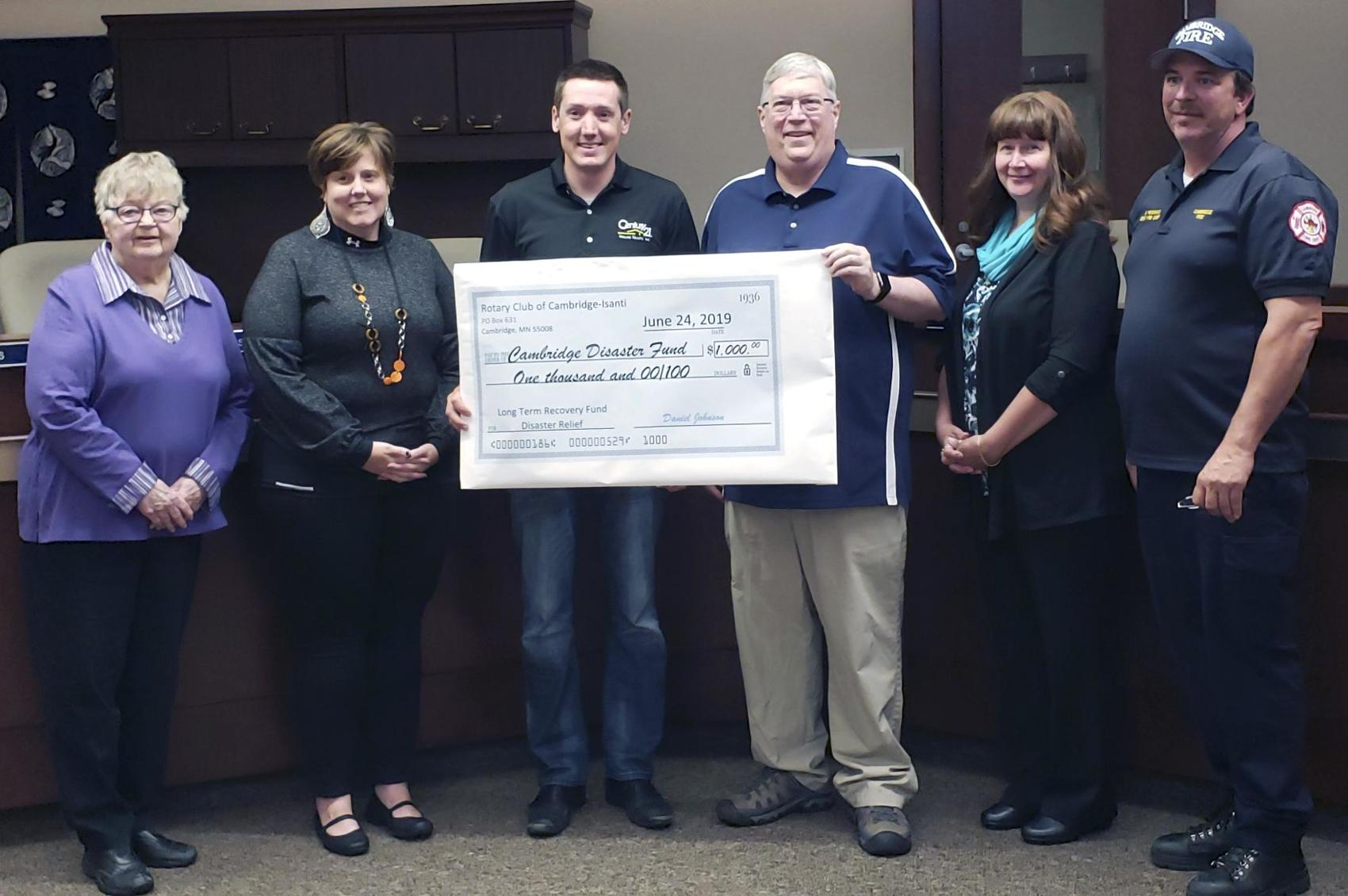 City Council accepting a donation check